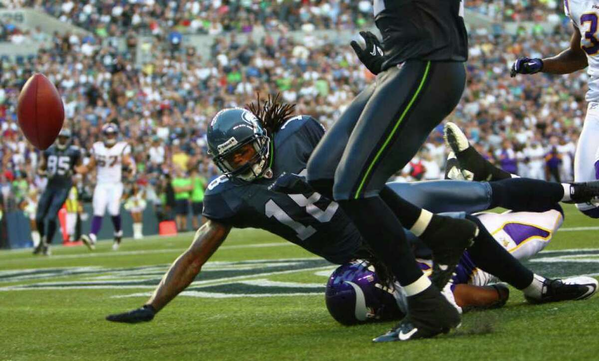 Seahawks player Sidney Rice reaches for the ball.