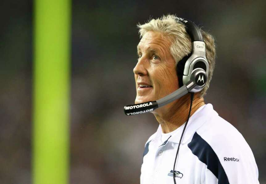 Seahawks coach Pete Carroll walks the sidelines.