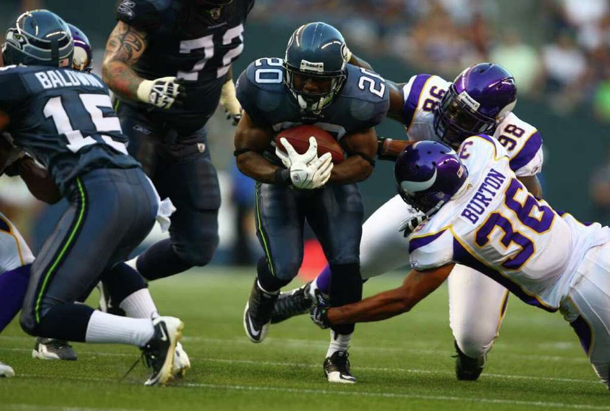Seahawks player Justin Forsett runs with the ball.
