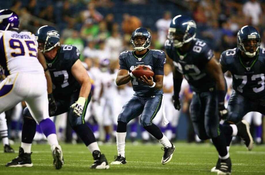 Seahawks quarterback Josh Portis looks downfield. Photo: JOSHUA TRUJILLO / SEATTLEPI.COM