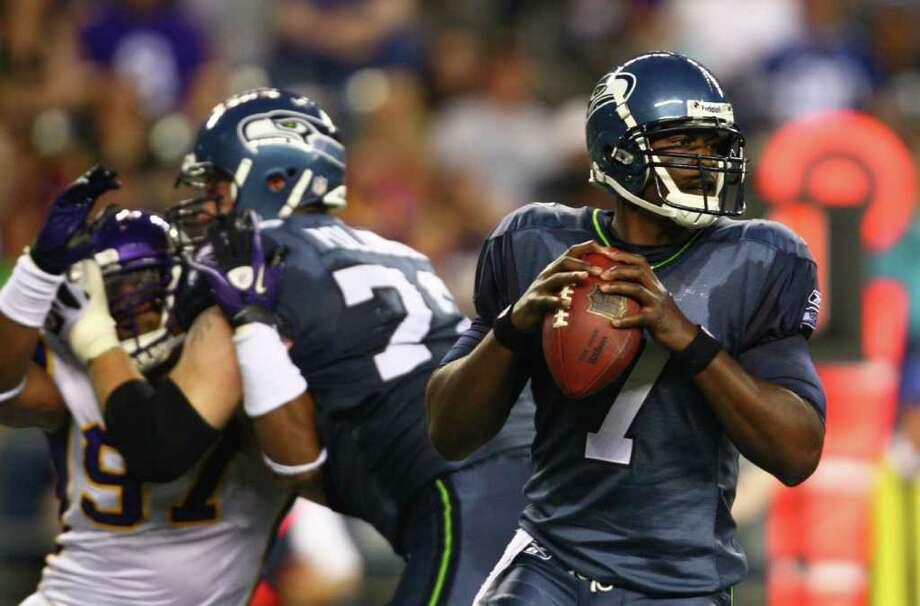 Seahawks quarterback Tarvaris Jackson prepares to throw the ball. Photo: JOSHUA TRUJILLO / SEATTLEPI.COM