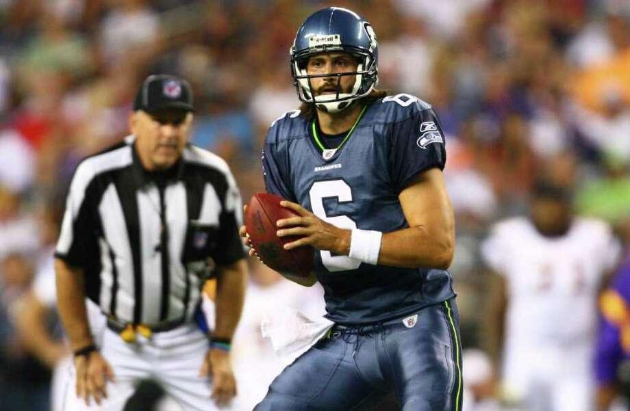 Seahawks quarterback Charlie Whitehurst prepares to throw the ball. Photo: JOSHUA TRUJILLO / SEATTLEPI.COM