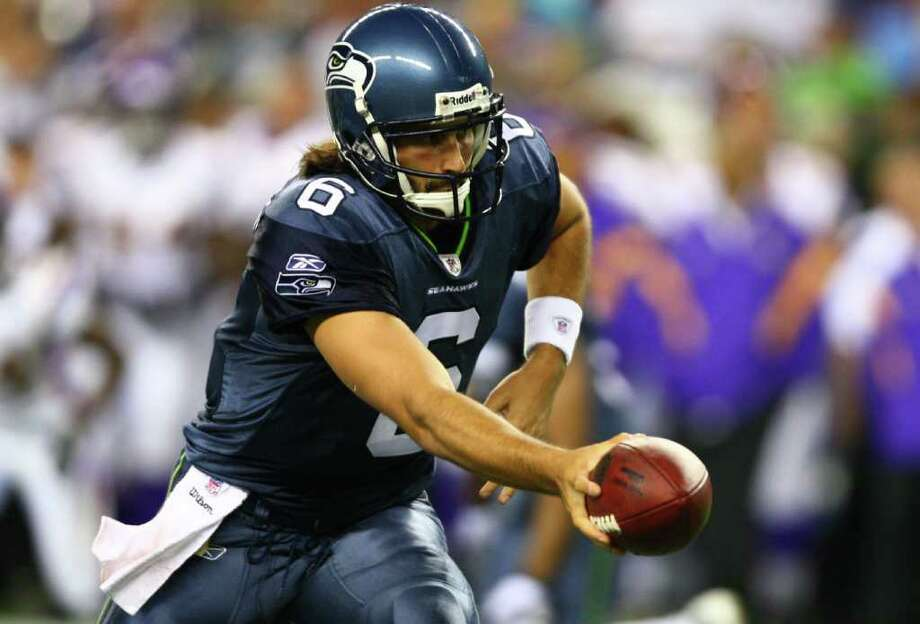 Seahawks quarterback Charlie Whitehurst (6) hands off the ball. Photo: JOSHUA TRUJILLO / SEATTLEPI.COM