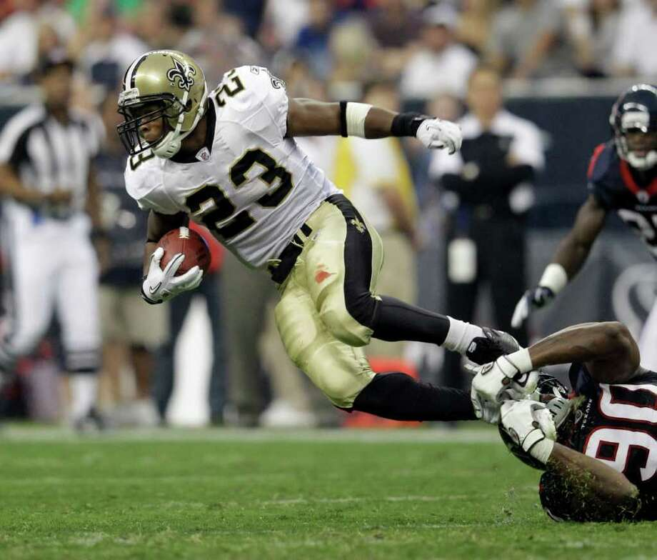 Now a linebacker, Mario Williams, bottom right, had two tackles against the Saints, including one of running back Pierre Thomas. Williams moved to linebacker from defensive end this season. (AP Photo/Eric Gay) Photo: Eric Gay, Associated Press / AP
