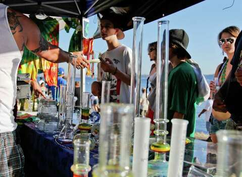 A man purchases a bong at Hempfest on Saturday August 20, 2011 along the east coast of Elliott bay in Seattle Photo: JOE DYER / SEATTLEPI.COM