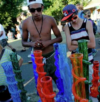 People shop for bongs at Hempfest on Saturday August 20, 2011 along the east coast of Elliott bay in Seattle Photo: JOE DYER / SEATTLEPI.COM