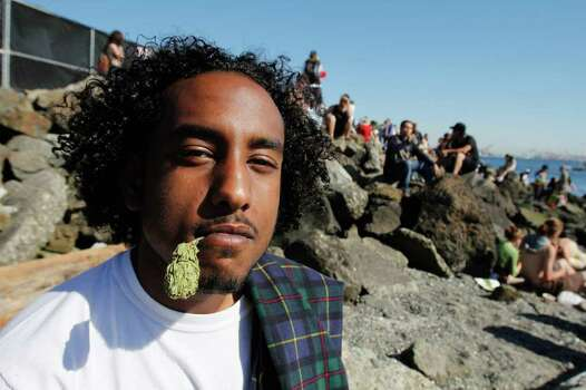 "Polo Mal holds a some ""G13 Classified,"" Marijuana in his mouth at 4:20PM at Hempfest on Saturday August 20, 2011 along the east coast of Elliott bay in Seattle Photo: JOE DYER / SEATTLEPI.COM"