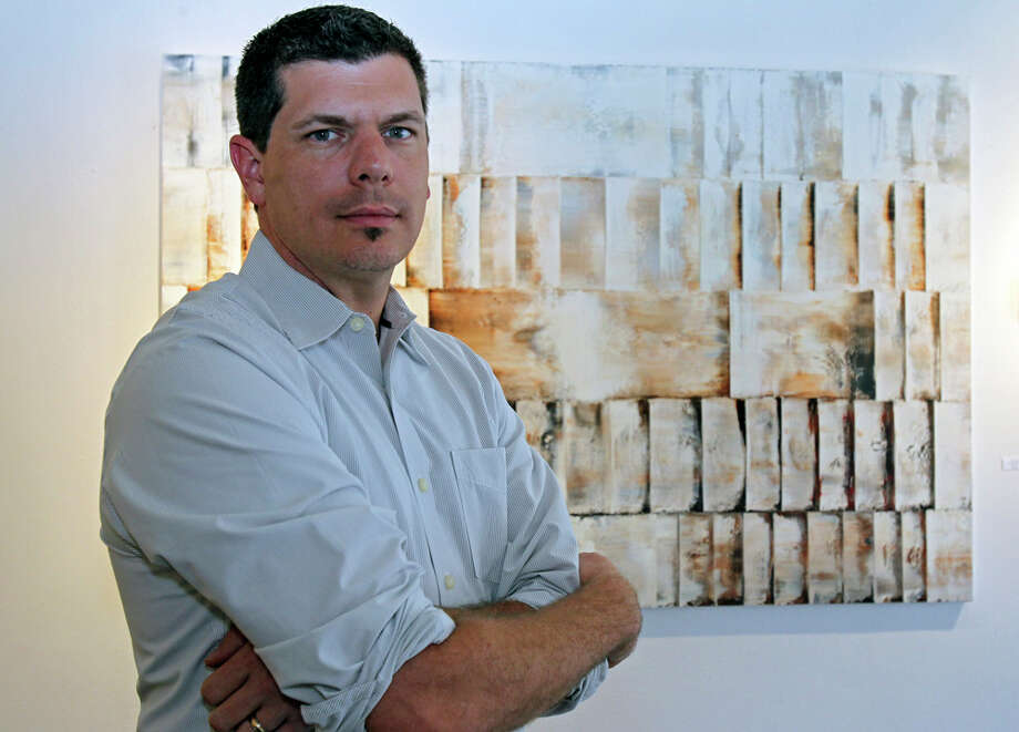 "Russell Stephenson stands in front of ""No. 9,"" one of his works on display at Anarte Gallery. TOM REEL / EXPRESS-NEWS Photo: TOM REEL, SAN ANTONIO EXPRESS-NEWS / © 2011 San Antonio Express-News"