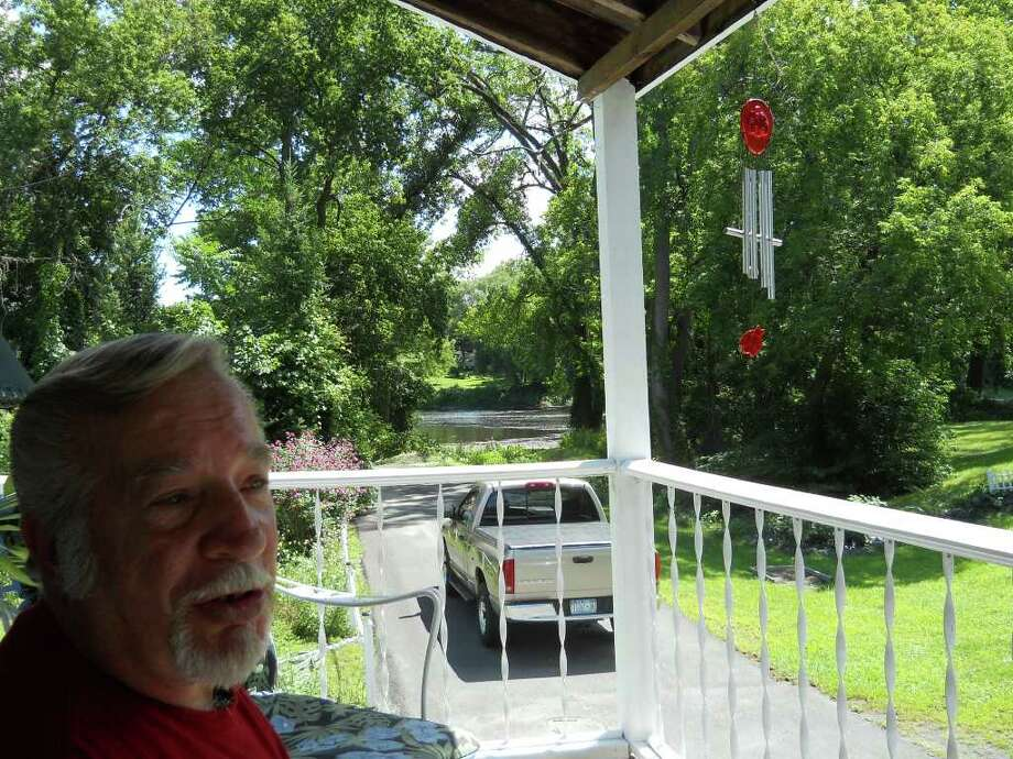 Don Pier sits on his porch at his Cedar Street home. (Larry Rulison / Times Union)