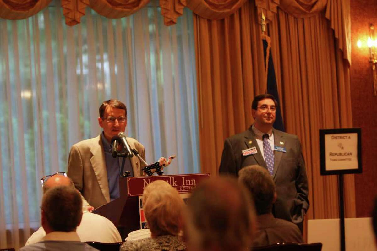 Jerry Labriola, recently elected chairman of the Connecticut Republican Party, addresses the Norwalk Republican Town Committee last Thursday at the Norwalk Inn and Conference Center as RTC chairman Art Scialabba looks on.