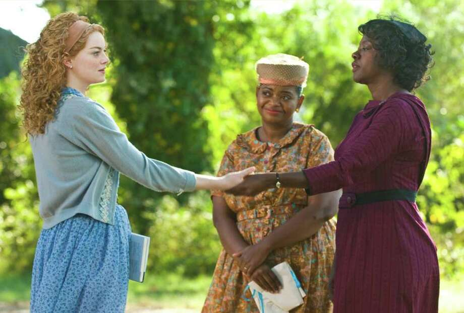 """File - In this undated file film publicity image released by Disney, from left, Emma Stone, Octavia Spencer and Viola Davis are shown in a scene from """"The Help.""""  """"The Help"""" continues to clean up at the box office, taking over the No. 1 spot with $20.5 million in its second weekend. (AP Photo/Disney, Dale Robinette, File) Photo: Dale Robinette"""