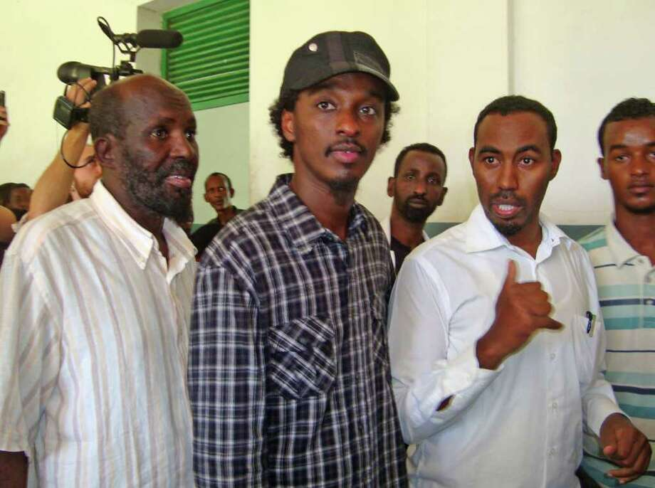 Canadian based Somali rapper K'naan, centre, visits Mogadishu's Banadir hospital, Somalia Sunday,  Aug, 21 2011. The singer who was mobbed by famine refugees trying to shake his hand or get a hug, said his mission is fact finding on how to help the people of Somalia and promised to do all that he can to assist them. (AP Photo/Farah Abdi Warsameh) Photo: Farah Abdi Warsameh / AP
