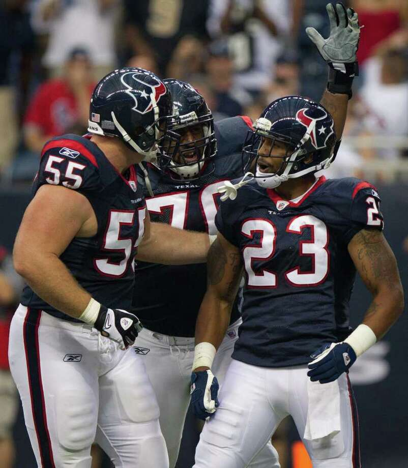 Houston Texans running back Arian Foster (23) celebrates a 2-yard touchdown run with center Chris Myers (55) and tackle Duane Brown (76) during the first quarter of an NFL preseason football game at Reliant Stadium Saturday, Aug. 20, 2011, in Houston.  ( Smiley N. Pool / Houston Chronicle ) Photo: Smiley N. Pool, Houston Chronicle / © 2011 Houston Chronicle