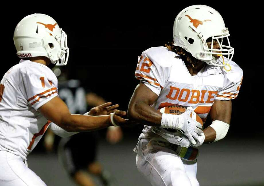 Dobie running back Andrew Robinson, right, rushed for 810 yards and seven touchdowns last season. Photo: Melissa Phillip, Houston Chronicle / Houston Chronicle