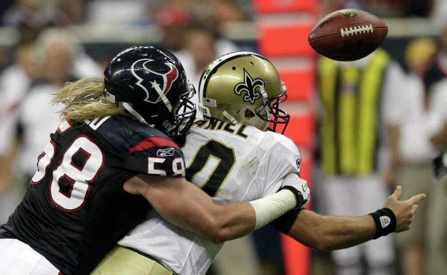 The strong showing by rookie linebacker Brooks Reed, left, on Saturday night included forcing a fumble by Saints quarterback Chase Daniel. Photo: Brett Coomer, Houston Chronicle / © 2011 Houston Chronicle