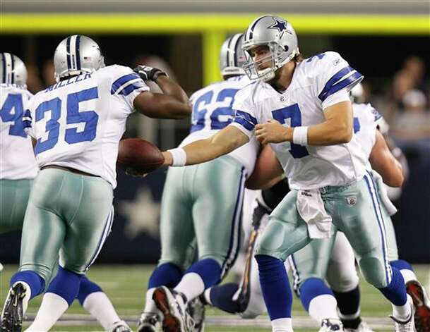 Dallas Cowboys quarterback Stephen McGee (7) hands off to running back Lonyae Miller (35) in the second half of a preseason NFL football game against the San Diego Chargers Sunday, Aug. 21, 2011, in Arlington, Texas. (AP Photo/LM Otero) Photo: Associated Press