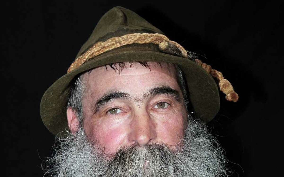 CHUR, SWITZERLAND - AUGUST 21: A bearded man poses ahead of the 26th International Alpine Beard Competition on August 21, 2011 in Chur, Switzerland. Participants from Switzerland, Bavaria and Austria are to be chosen for the most genuine, natural grown beard. (Photo by Johannes Simon/Getty Images)