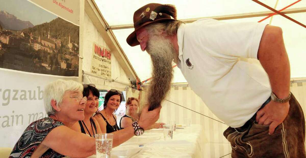 CHUR, SWITZERLAND - AUGUST 21: A participant of the 26th International Alpine Beard Competition presents himself to the jury on August 21, 2011 in Chur, Switzerland. Bearded men from Switzerland, Bavaria and Austria are to be chosen for the most genuine, natural grown beard. (Photo by Johannes Simon/Getty Images)