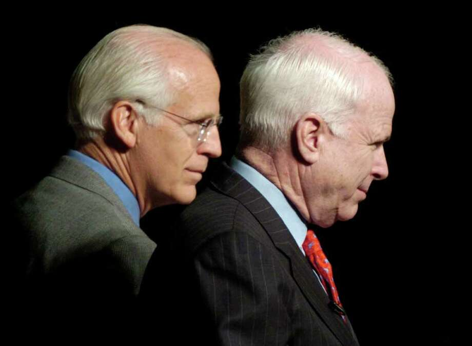 FILE 2004 - Congressman Christopher Shays, left, and Sen. John McCain, right, look out to the crowd during a town hall meeting at the Saugatuck Elementary School in Westport. Photo: File Photo / Stamford Advocate File Photo