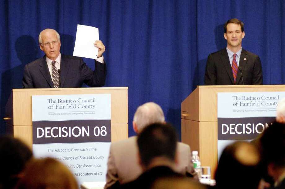FILE 2008 - Congressman Christopher Shays hold up a blank piece of paper to show opponent Jim Himes' voting record during debate sponsored by the Business Council of Fairfield County. Himes ultimately won the race. Photo: File Photo / Stamford Advocate File Photo