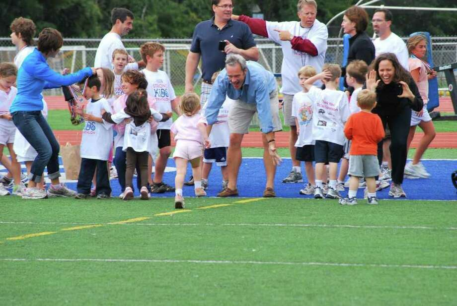 Children participate in the 100-meter dash during last year's Strong Kids Triathlon. Photo: Contributed Photo