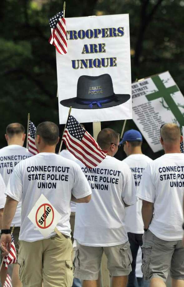 The Connecticut State Police Union holds a rally at the Capitol in Hartford, Conn., Monday, Aug. 22, 2011.  Union leaders say state police are already understaffed and cutting 56 troopers is a dangerous proposal that could result in slower emergency response times.  (AP Photo/Jessica Hill) Photo: Jessica Hill, Associated Press / Connecticut Post