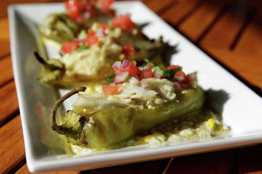 Crabby Hatch stuffs hatch chiles with a crabmeat and cheese mix, served on Corn Crema. Photo: Melissa Phillip, Houston Chronicle / © 2011 Houston Chronicle