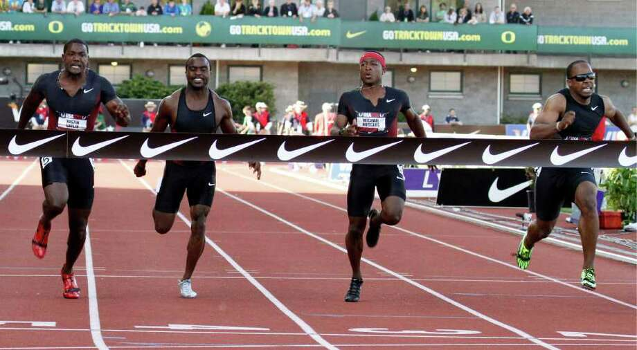 Ivory Williams, second to left, competes in the 100-meter run in the 2011 U.S. Track and Field Outdoor Championships. Photo: AP, STF / AP2011
