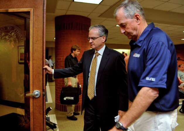 Connecticut basketball head coach Jim Calhoun, right, and Director of Athletics Jeff Hathaway leave a news conference in Storrs, Conn., Friday, May 28, 2010.  The University says the NCAA has found eight violations in the school's men's NCAA college basketball program. (AP Photo/Jessica Hill) Photo: Jessica Hill, ST / AP2010