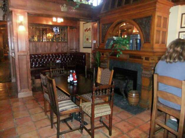 The wood framed fireplace at the British pub, the Dog & Bee. Photo: Courtesy Photo