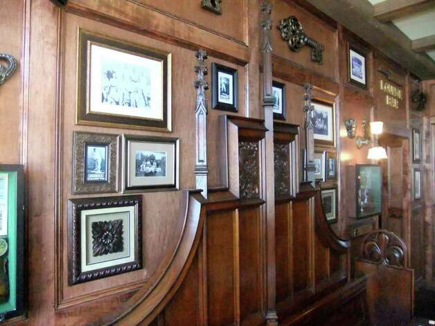Photographs and other art adorn the walls at the Dog and Bee. Photo: Courtesy Photo