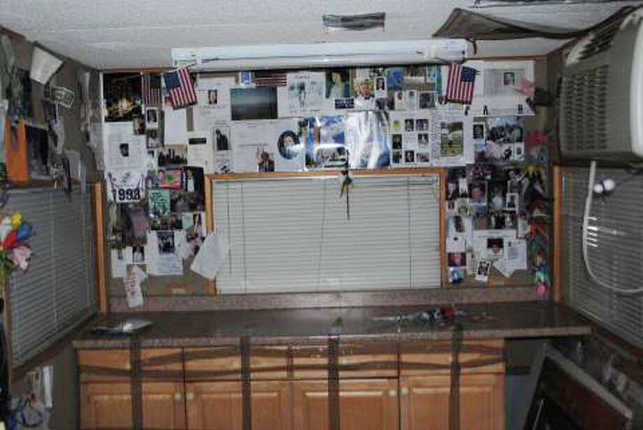 "Inerior of ""the Family House,"" a trailer filled with photos and mementos of victims of the 9/11 terror attacks. (Courtesy NYS Museum)"