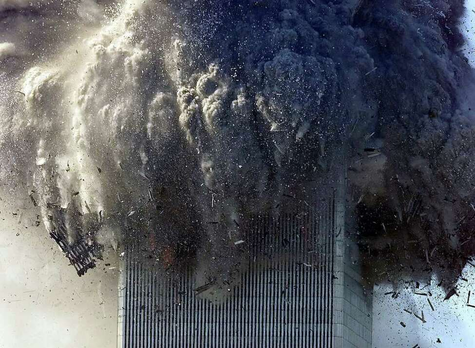 **FILE** One World Trade Center collapses following the terrorist attack on Sept. 11, 2001. The New York Times staff won both Pulitzer Prizes in photography, for breaking news and for feature coverage, Monday, April 8,2002. This photo is part of the breaking news package. (AP Photo/NY Times,Chang W. Lee) ** FOR USE ONLY WITH STORIES ON PULITZER PRIZE -- ALL OTHER USE PROHIBITED**