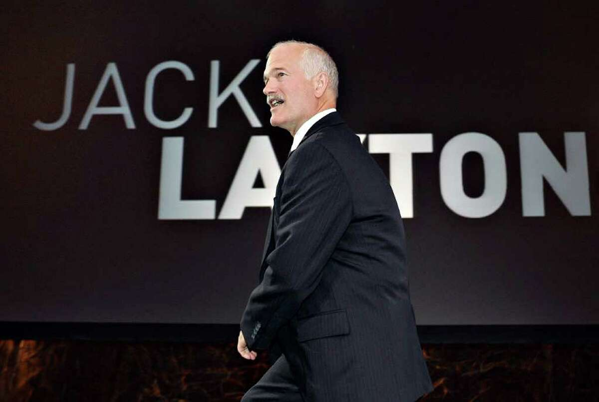 In this Sept. 10, 2006 photo, federal NDP leader Jack Layton walks on stage for his closing speech at the end of a three-day convention in Quebec City. Layton died Monday, Aug. 22, 2011, after a battle with cancer. (AP Photo/The Canadian Press, Jacques Boissinot)