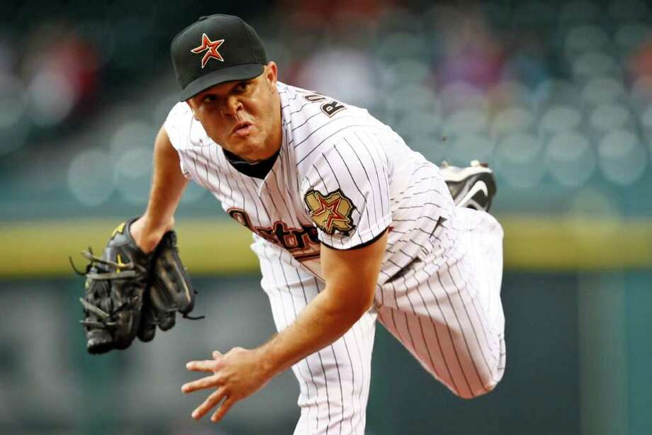 Houston Astros starting pitcher Wandy Rodriguez (51) throws a pitch during the 1st inning of the Houston Astros vs. the Chicago Cubs MLB baseball game at Minute Maid Park, Wednesday, April 13, 2011, in Houston. ( Michael Paulsen / Houston Chronicle ) Photo: Michael Paulsen, Staff / Houston Chronicle