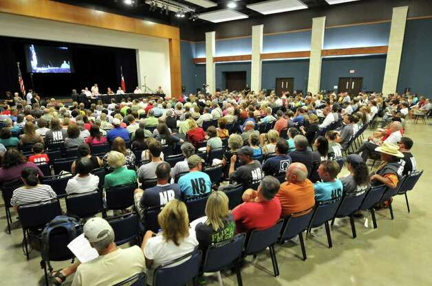 A large crowd gathered for the New Braunfels City Council meeting to discuss a proposed ordinance banning disposable containers on the Comal River. The large group forced the council to hold the meeting at the New Braunfels Convention Center. Photo: Robin Jerstad/Special To The Express-News / Robert Jerstad