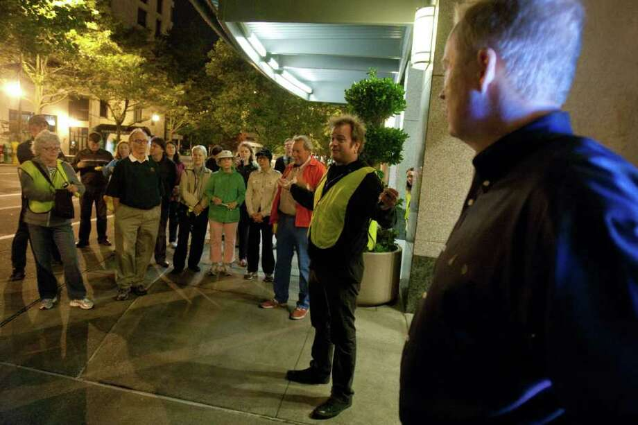 Members of Belltown Citizens on Patrol meet in front of Seattle Heights Condominiums early on Tuesday, August 23, 2011 after a patrol of Seattle's Belltown neighborhood. Concierge Matt Hale, who works at the building, was nearly beaten to death when he was jumped by five men in the neighborhood. Photo: JOSHUA TRUJILLO / SEATTLEPI.COM
