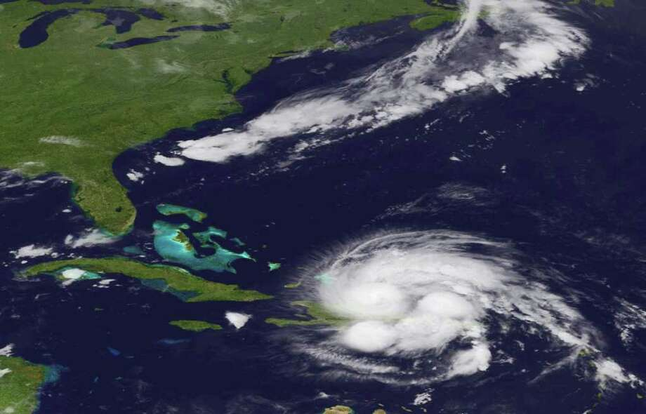 An image released by the NOAA made from the GEOS East satellite shows Hurricane Irene on Aug. 23, 2011 as it passes over Puerto Rico and the Dominican Republic.  The storm is on a track that could see it reach the U.S. Southeast as a major storm by the end of the week. (AP Photo/NOAA) Photo: HOPD / NASA