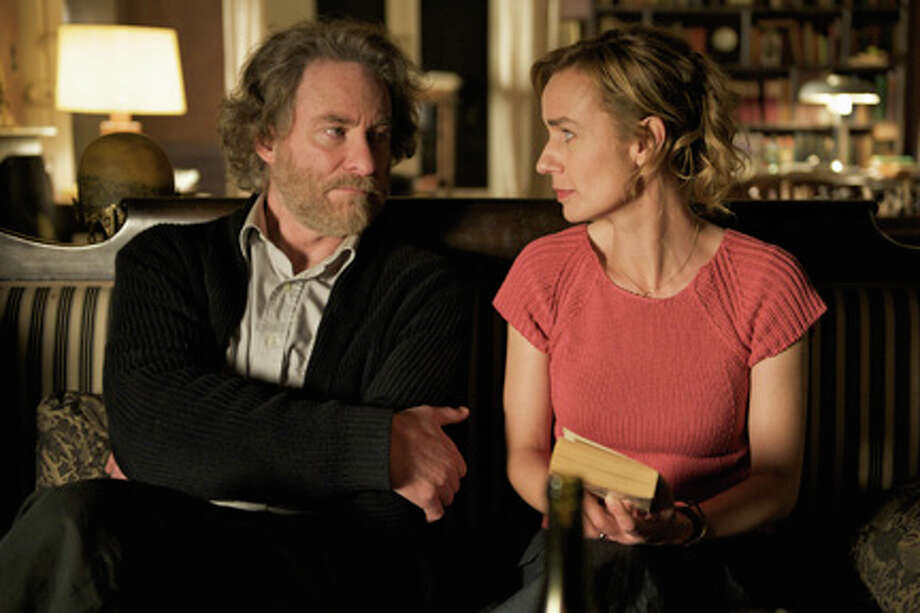 "Kevin Kline as Kröger and Sandrine Bonnaire as Hélène in ""Queen to Play."""