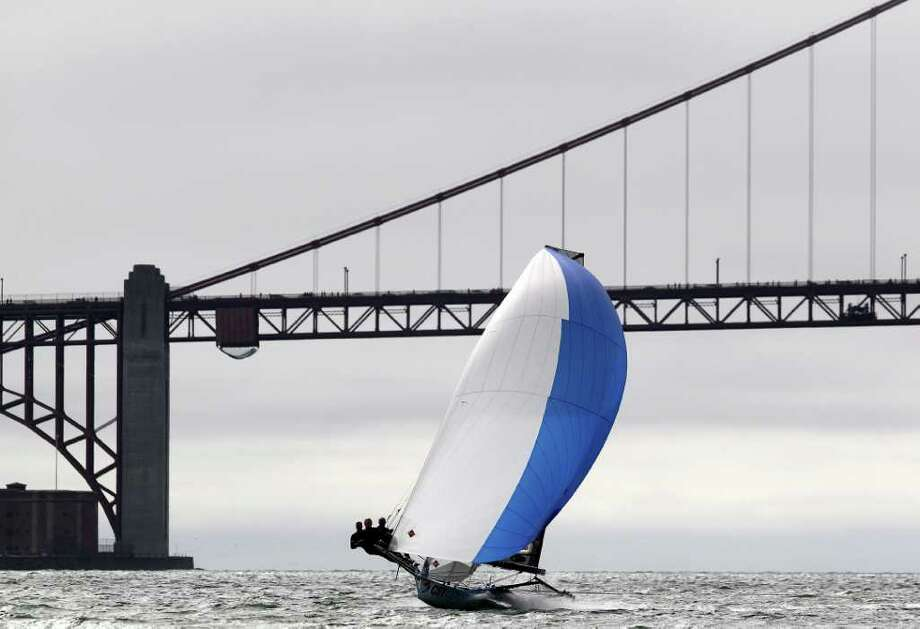 The CST Composites boat skippered by Howie Hamlin competes in day two of the 18ft Skiff International Regatta hosted by the St. Francis Yacht Club on August 22, 2011 in San Francisco, California. Photo: Ezra Shaw, Getty Images / 2011 Getty Images