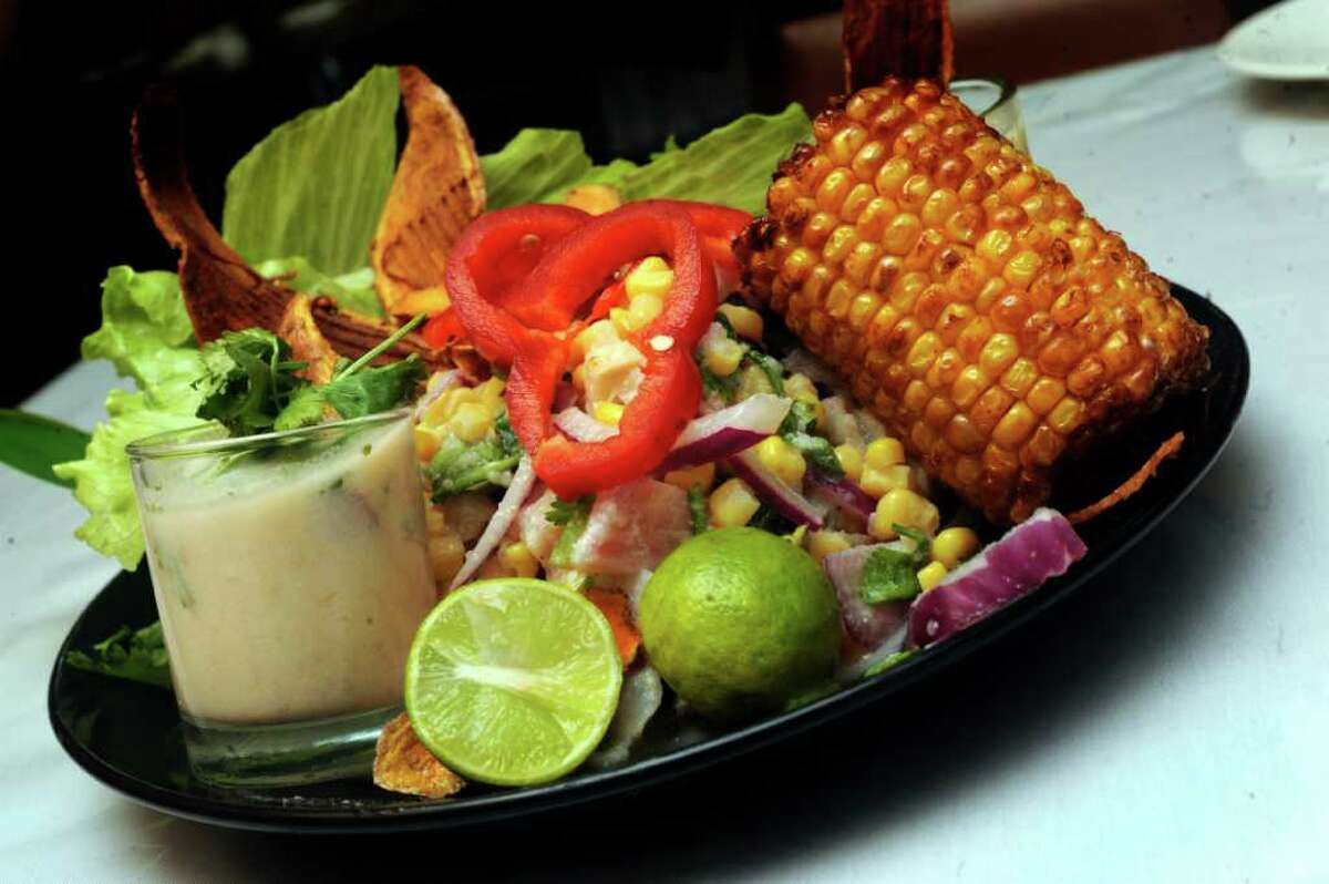 The ceviche de pescado is served with a small glass of the marinating juice, which is called leche de tigre.