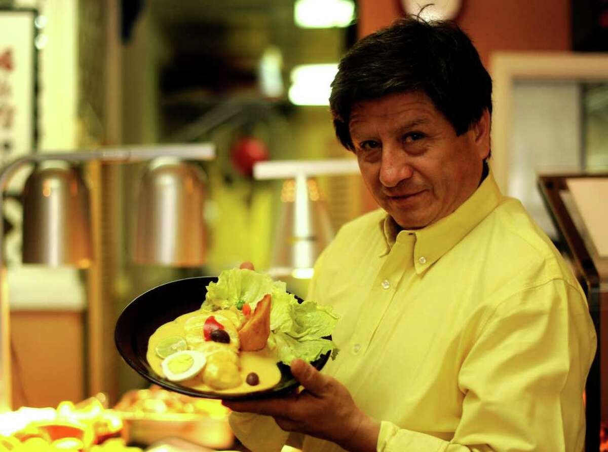 Chef Waldo Castro of Ceviche de Waldito shows an order of papa a la huacaina.
