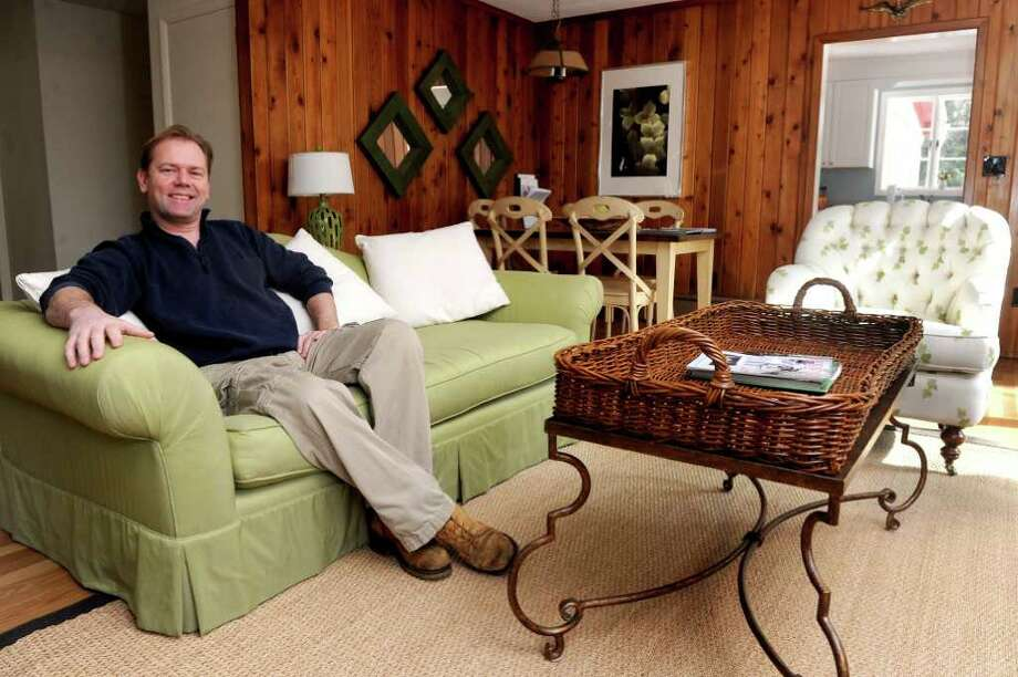 George Knapp, property manager at 4 Lehn Farm Rd in Westport, poses for a photo in the house, which is for sale. Photo: Lindsay Niegelberg