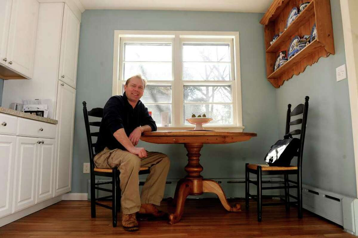 George Knapp, property manager at 4 Lehn Farm Rd in Westport, poses for a photo in the house, which is for sale.
