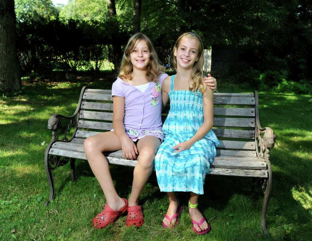 Twins Sydney and Jennifer Winthrop, 9, at their Westport home, Saturday, Aug. 20, 2011. The girls were born at Greenwich Hospital on Sept. 11, 2001, the day America was attacked by terrorists using hijacked airplanes.