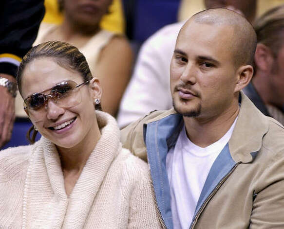 Who: Jennifer Lopez and Cris Judd