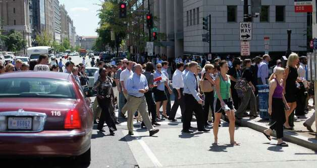 Pedestrians cross an intersection of downtown Washington, Tuesday, Aug. 23, 2011, after office buildings where evacuated following a reported 5.9 earthquake was felt in Washington. The earthquake centered northwest of Richmond, Va., shook much of Washington, D.C., and was felt as far north as Rhode Island and New York City. Photo: Pablo Martinez Monsivais, AP / AP