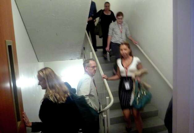 People use the stairs to evacuate a building in Washington, Wednesday, Aug. 24, 2011, after an earthquake hit the Washington area. The 5.9 magnitude earthquake centered northwest of Richmond, Va., shook much of Washington, D.C., and was felt as far north as Rhode Island and New York City. Photo: Charles Dharapak, AP / AP