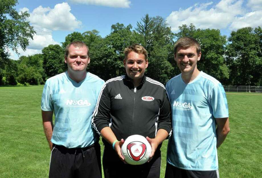 A 2011 file photo of Barry Beattie, right, posing next to area coaches Wayne Rooney, left, and David Barton, center. Beattie is taking over as head coach at Staples High School girls team. Photo: Amy Mortensen / Connecticut Post Freelance