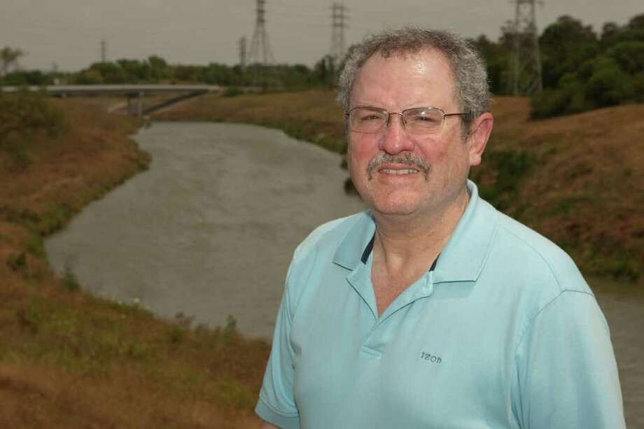 UH Prof. Martin Melosi stands in front of Brays Bayou. Photo: Photo Courtesy UH